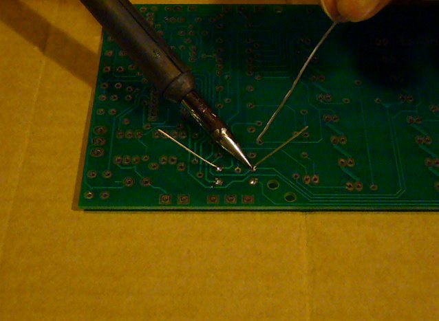 Applying heat to solder joint, heating PC board and component lead