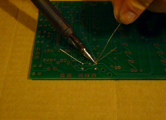 Adding solder to the heated joint